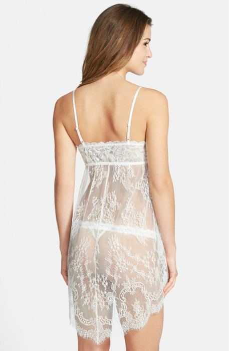 An ethereal Empire-waist chemise makes a romantic entrance in wispy and delicate vintage-inspired ivory lace with a coordinating G-string.
